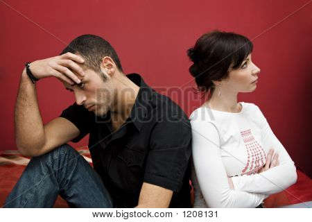 relationship difficulties: young couple having a fight stock photo