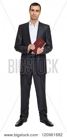 Man portrait in black suit with book on white at studio stock photo