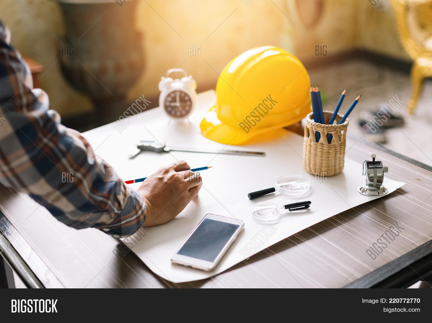 Architect Or Construction Engineer Sketching A Construction Project On Drawing Table With Engineerin