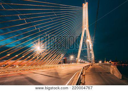 Shrouds Of Vansu Bridge formerly Gorky Bridge In Riga, Latvia. 595 Meters In Length. Vansu Bridge - One Of The Symbols Of Modern Riga. Cable-Stayed Bridge That Crosses The Daugava River. stock photo