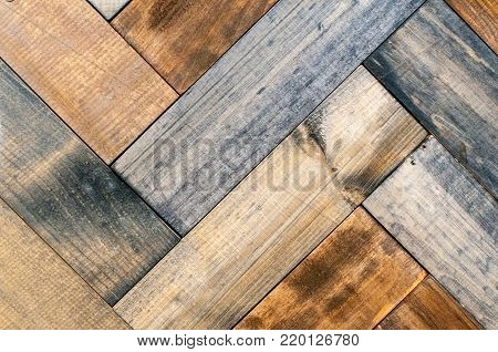 fragment of parquet paintings on the wall of the different types of wood.