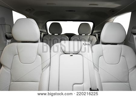 Luxury car inside. Interior of prestige modern car. Comfortable leather seats. Red perforated leather cockpit stock photo