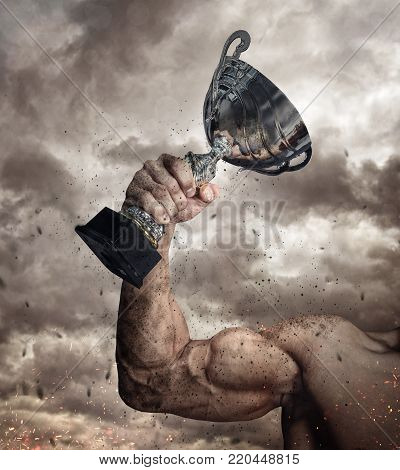 Cropped male arm with winner cup under cloudy sky. stock photo