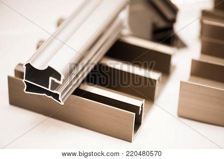 Aluminium extrusion,aluminium profile process anodizing. Material. New Anodized Aluminum Profile Products stock photo
