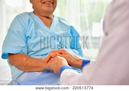 Concept of healing care, The doctor is healing  old woman.