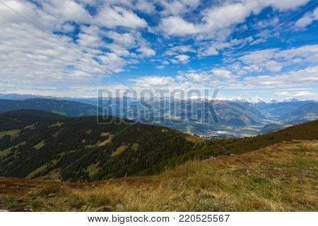 View of Austrian Alps mountain range, valley, snowy glacier mountains from afar, Autumn view from Mount Kronplatz, South Tyrol, Italy, Europe stock photo