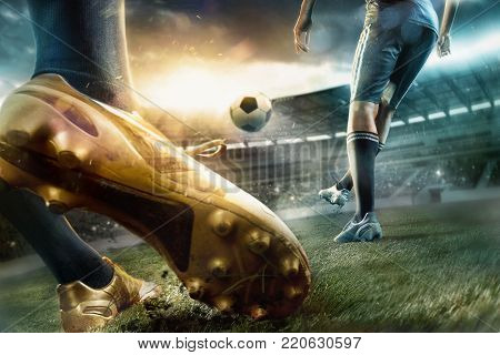 The legs of soccer football players training football on green grass field. Advertising concept of soccer football