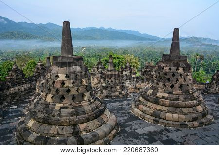 Borobudur Temple at early morning in Java Island, Indonesia. Borobudur is the largest Buddhist temple (stupa) in the world. stock photo