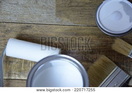 White paint, paint brush, roller for paint, repair concept. for painted surface with a waterproof paint by cushion and brush stock photo