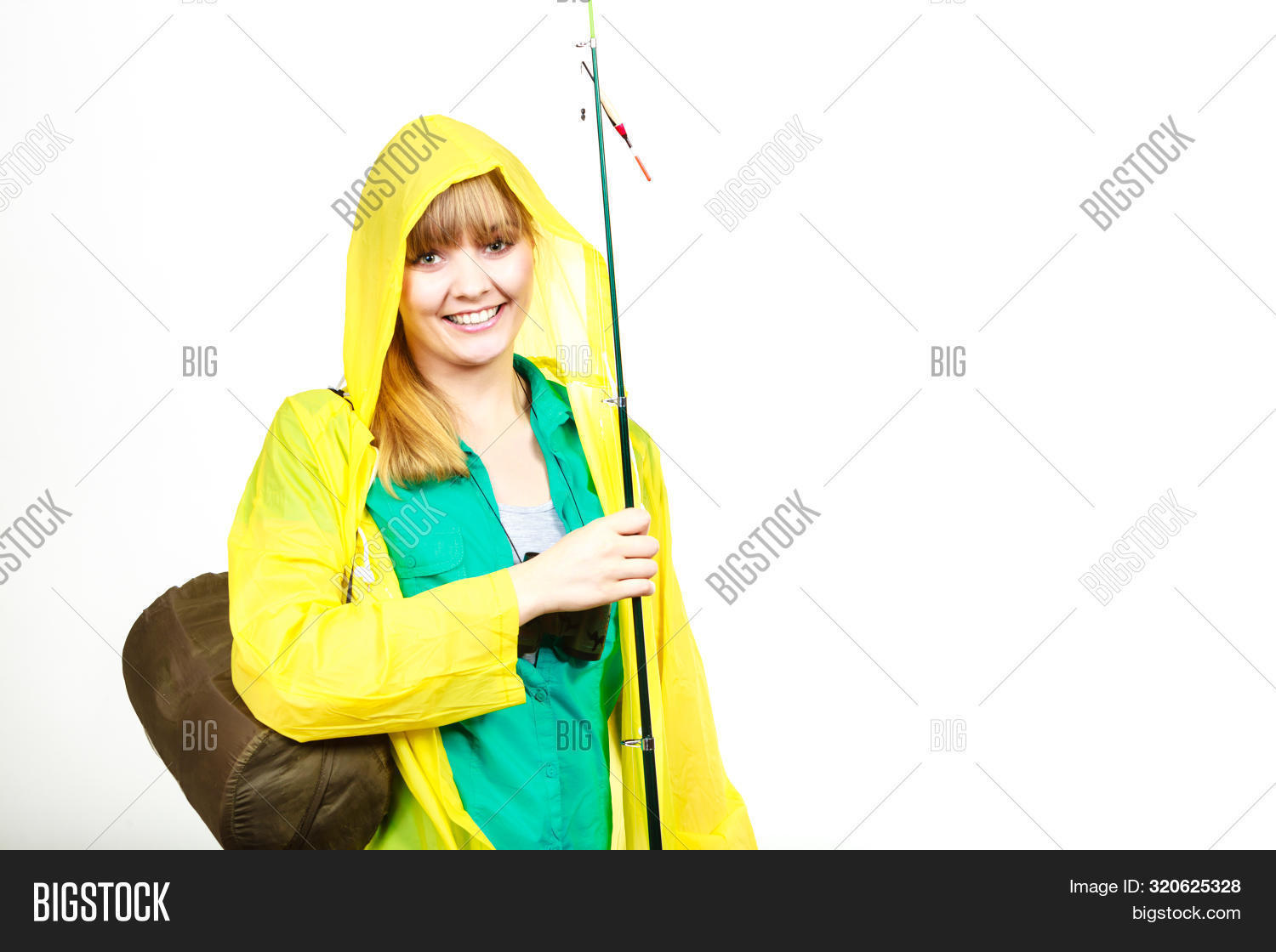 Fishery, Spinning Equipment, Angling Sport And Activity Concept. Woman Wearing Raincoat Holding Fish