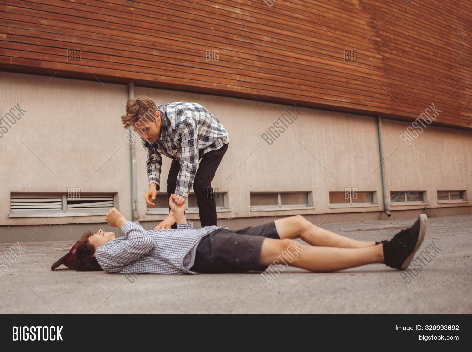 Injury Accident, A Guy Lay On The Ground Outdoor, Another Man Come And Help In The City S
