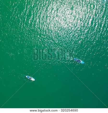 Aerial view of sup boards on the sea. Top view of two paddleboard on a sunny day. View from above. stock photo