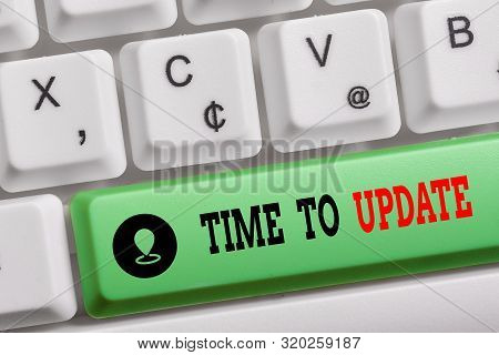 Conceptual hand writing showing Time To Update. Business photo text act updating something someone or updated version program Keyboard with note paper on white background key copy space. stock photo