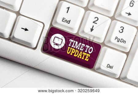 Handwriting text writing Time To Update. Concept meaning act updating something someone or updated version program White pc keyboard with empty note paper above white background key copy space. stock photo