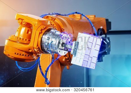 Automated hand robot technical production, measurement, study of the parameters of objects. Industrial techno theme stock photo