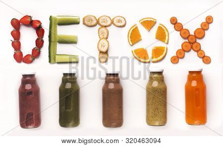 Assorted flavoured detox drinks with fresh fruits and vegetables text above on white background, panorama stock photo