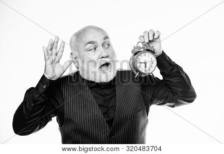 Being late is habit. time management. business startup. retirement. watchmaker or watch repairer. mature man with beard clock show time. mature bearded man with alarm clock. time and age. Timekeeping stock photo