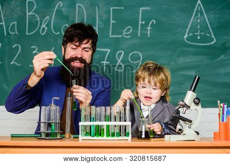 Perseverance pays off. Attention deficit hyperactivity disorder. Teacher child test tubes. School lesson. Chemical experiment. Difficult focus and complete school tasks. Symptoms of ADHD at school stock photo
