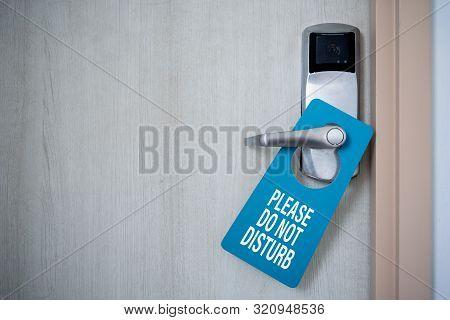 Closed door of hotel room with please do not disturb sign. Hotel Door Hanger Tags Mockup. stock photo