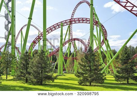 Funny roller coaster in the amusement Park. Day natural lighting stock photo