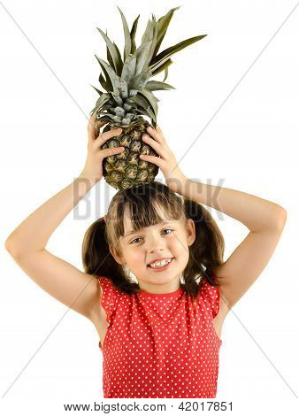 happy beauty little girl hold pineapple and smile on white background isolated stock photo