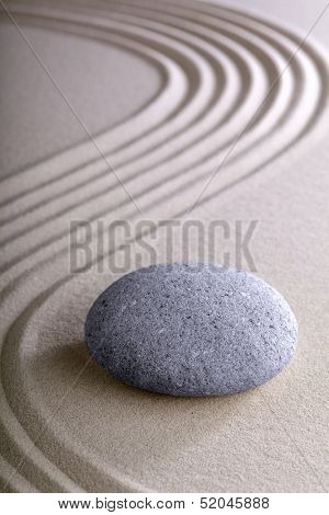 Japanese meditation or zen garden simplicity , calmness and balance in a pattern of lines in sand an