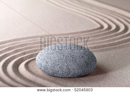 Zen garden japanese garden zen stone with raked sand and round stone tranquility and balance ripples