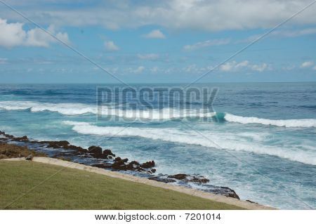 Waves from the Atlantic Ocean hitting the shore and rocks in Old San Juan, Pto. Rico, near the La Perla section. stock photo