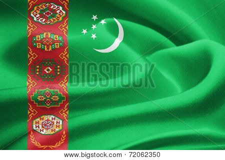 Flag of Turkmenistan waving in the wind. Silk texture pattern stock photo