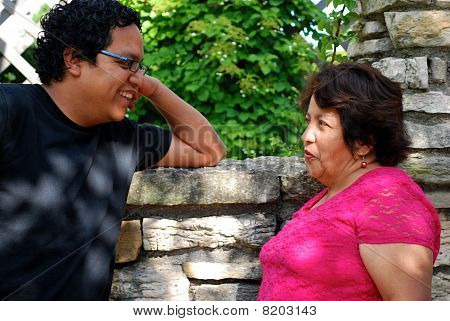 A Latin American mother with her grown son stock photo