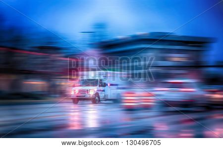 an ambulance racing through the rain on a stormy night with motion blur (NO SHARP FOCUS DUE TO RAIN