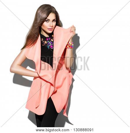 Fashion Model girl isolated over white background. Beauty stylish brunette woman posing in fashionab