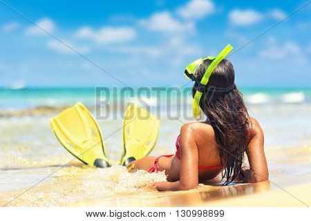 Beach vacation snorkel girl snorkeling with mask and fins. Bikini woman relaxing on summer holidays
