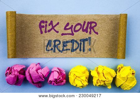 Handwriting text showing Fix Your Credit. Concept meaning Bad Score Rating Avice Fix Improvement Repair written tear sticky note Paper the blue background Folded paper stock photo