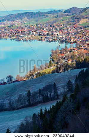 spa town schliersee at early springtime with frosty slope on a sunny morning. upper bavarian landscape in march stock photo