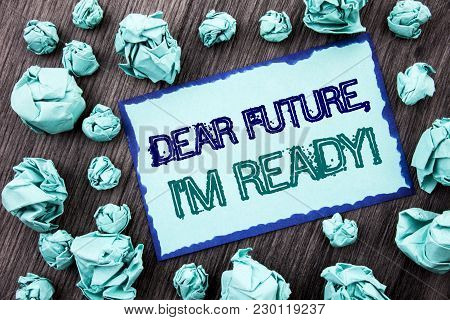 Conceptual hand writing text showing Dear Future, I Am Ready. Concept meaning Inspirational Motivational Plan Achievement Confidence written Sticky note paper folded paper the wooden background. stock photo