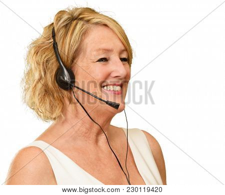 Portrait Of A Mature Woman Wearing Headset On White Background stock photo