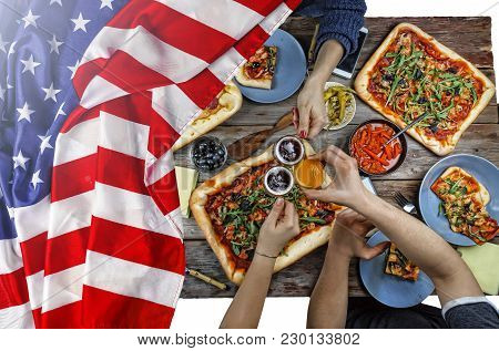 American Flag, US Flag, Independence Day, July 4, Happy Independence Day Celebrating Independence Day in the open air. A table with various snacks, barbecue stock photo