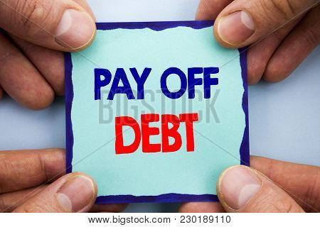 Handwriting Announcement text showing Pay Off Debt. Business photo showcasing Reminder To Paying Owed Financial Credit Loan Bills written Sticky Note Paper Holding Hand with Finger. stock photo