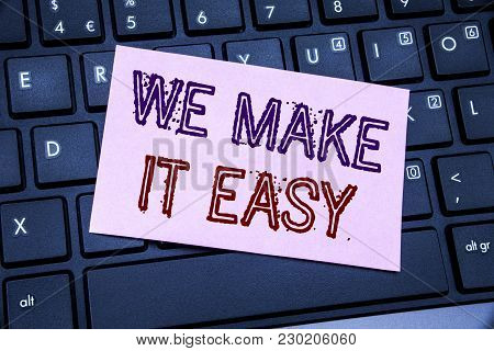 Handwriting Announcement text showing We Make It Easy. Business concept for Help Quality Solution written on sticky note paper on black keyboard background. stock photo