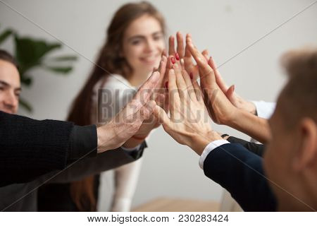 Motivated Successful Business Team Giving High Five, Happy Young Students Employees Group Join Hands