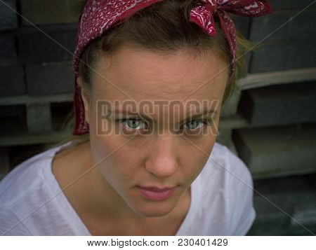 A young woman with green gazing eyes looks inquiringly stock photo