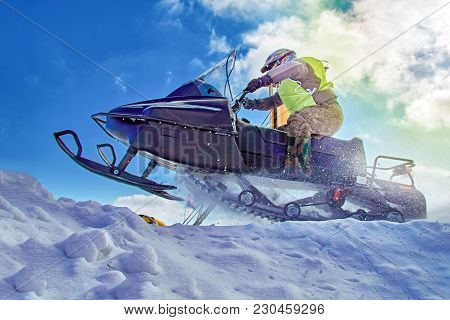 Extreme sport for lifestyle design. Winter extreme sport Snowmobile racing. Sport winter background for any purposes. stock photo