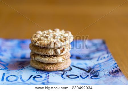 Cookies with peanuts on a blue plate. Cookies close-up. The inscription on the plates love stock photo