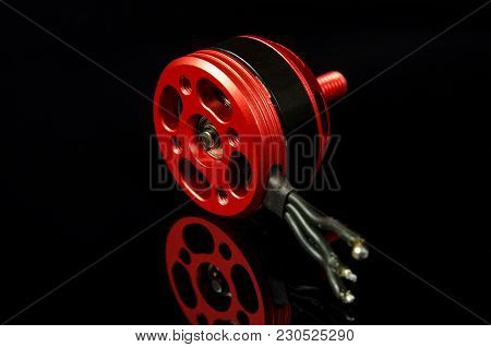 Small brushless motor for racing drones on the dark background stock photo