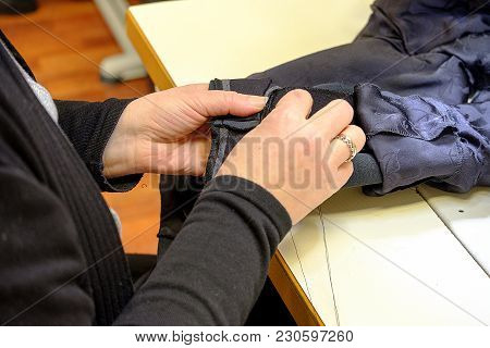 Yang women s hands behind her sewing .Haute Couture stock photo