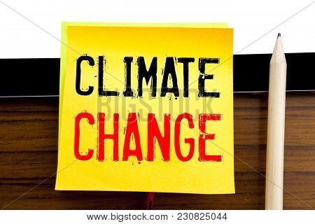 Hand writing text caption inspiration   Climate Change. Business concept for Global Planet Warming written on sticky note paper on wooden and tablet background. stock photo