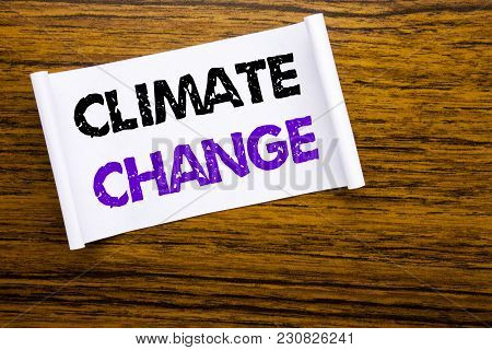 Word, writing Climate Change. Business concept for Global Planet Warming written on sticky note paper on wooden wood structure visible background. stock photo