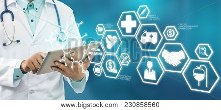 Medical Healthcare Concept - Doctor in hospital with medical icons modern interface showing symbol of medicine, innovation, medical treatment, emergency service, doctoral data and patient health. stock photo