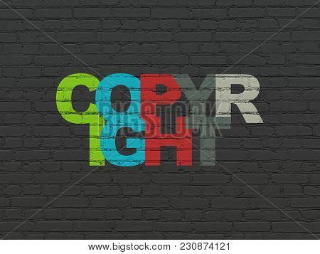 Law concept: Painted multicolor text Copyright on Black Brick wall background stock photo
